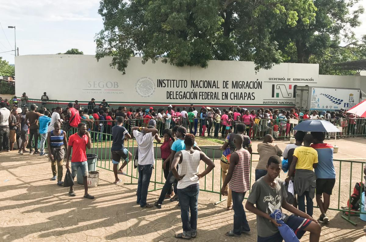 A line forms outside the migrant detention center in Tapachula, Mexico. Most are waiting to file some sort of paperwork with the National Immigration Institute. This facility holds more than 2,000 people in a site with a capacity for just 900.