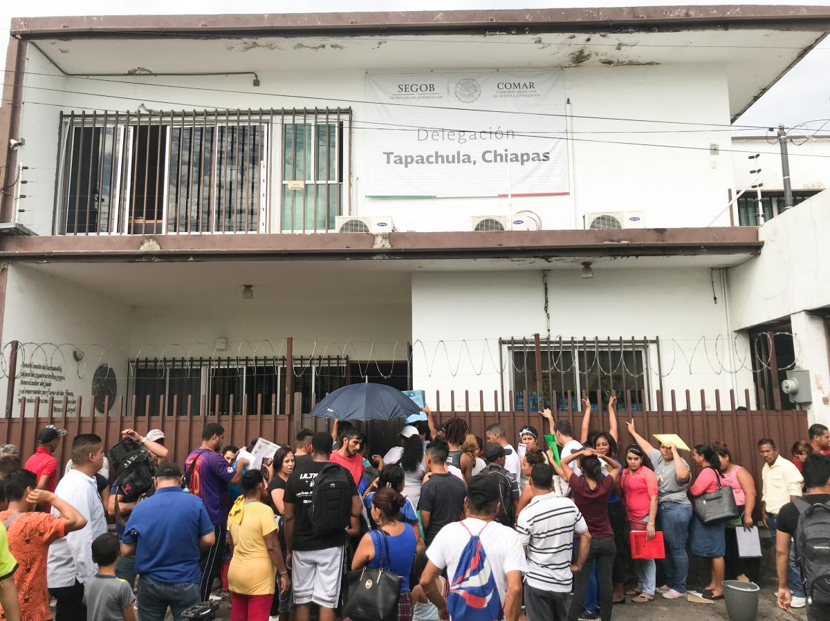 Hundreds of people wait outside the offices of the Mexican Commission for Refugee Aid in Tapachula, Mexico, to apply for asylum. Many have resorted to sleeping outside the office, fearing if they venture farther away, they will be arrested in migration ra
