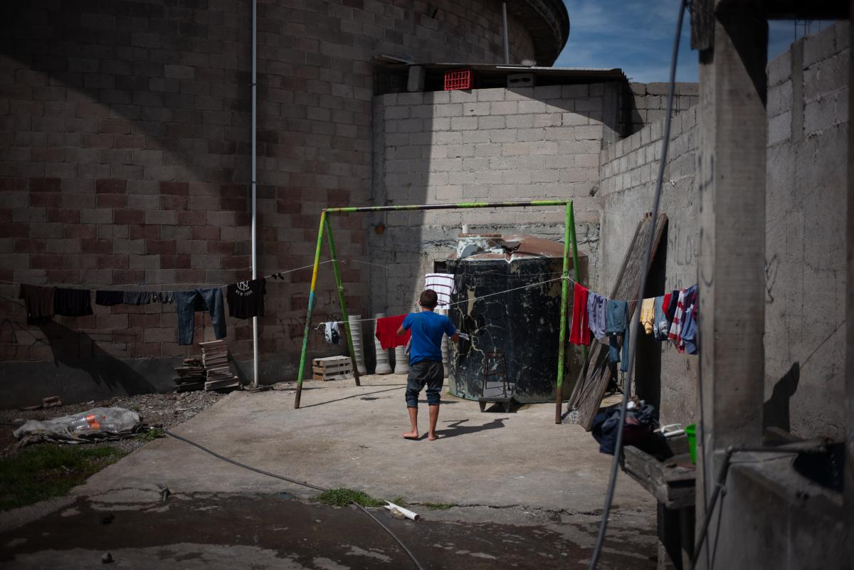 "A Central American migrant hangs his clothes at the refugee center Sagrada Familia. As migrants and asylum-seekers decide whether to risk the effects of the Trump administration's ""zero tolerance"" policy, Mexico's role as a possible destination country fo"
