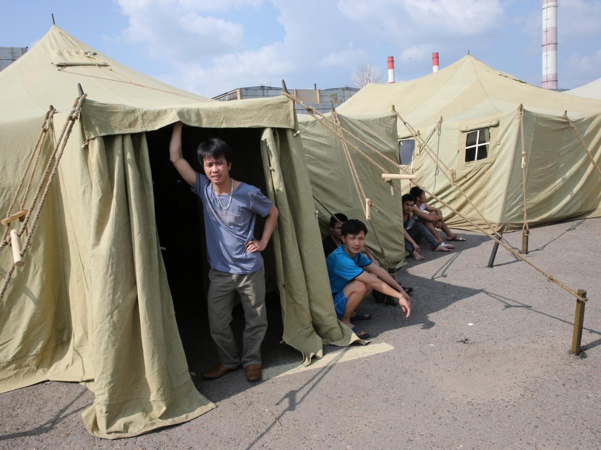 People in a temporary tent camp for illegal migrant workers in Moscow, on Saturday.