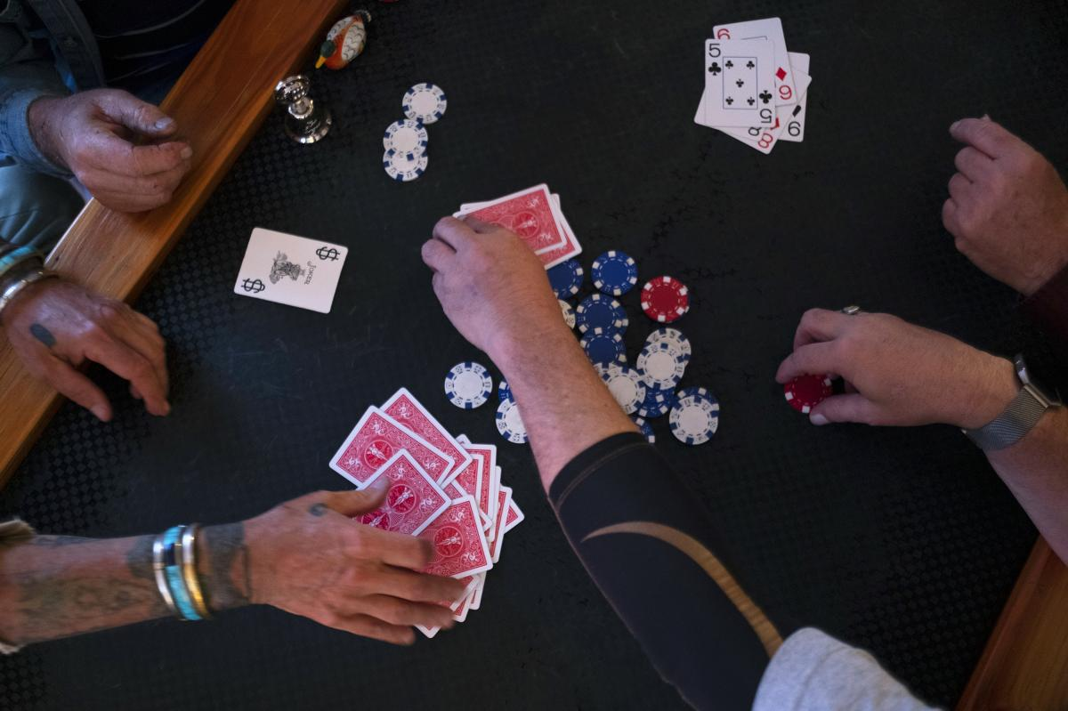 Joe Farrington hosts a weekly poker game on Tuesdays. Some in this group of friends have been playing together for nearly 40 years.