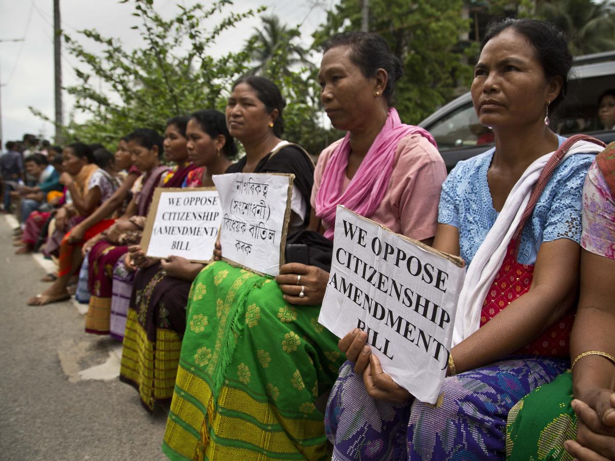 In Guwahati, Assam, in May 2018, indigenous women protest the Indian government's move to provide citizenship to minorities from Bangladesh, Pakistan and Afghanistan.