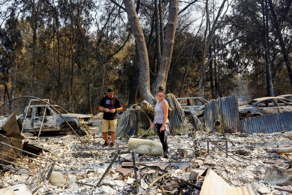 Ryan and Jennifer Montano search through the remains of their Vacaville, Calif., home, destroyed in the LNU Lightning Complex Fire in August.