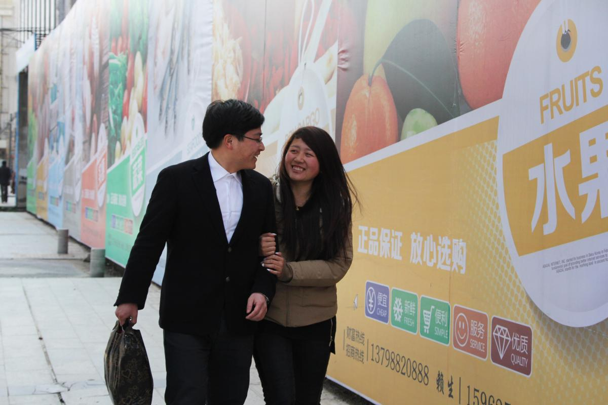Charles and Xiao Fang just picked up their wedding license. They recently got married over the Chinese New Year, a time when millions of Chinese in developed coastal cities return to their roots in the rural interior of the country. It's also a popular ti