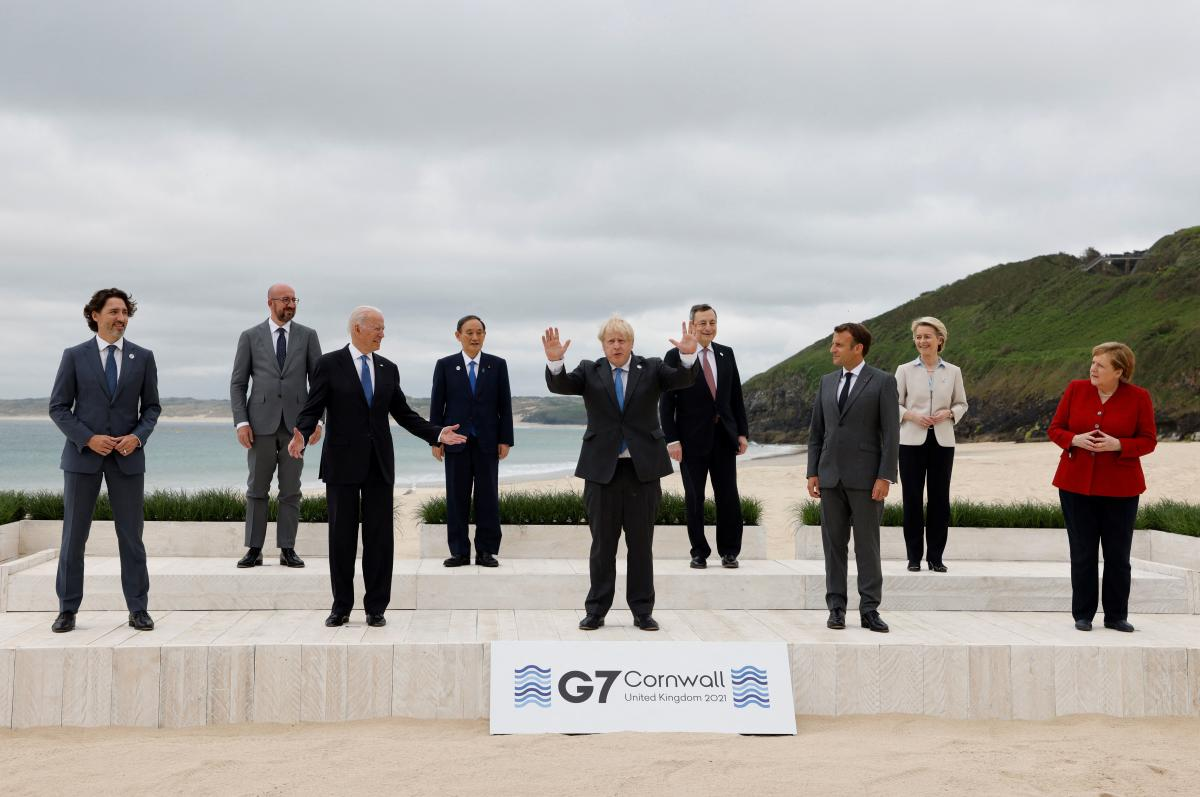 The G-7 leaders gather for the traditional group photo ahead of Friday's talks.