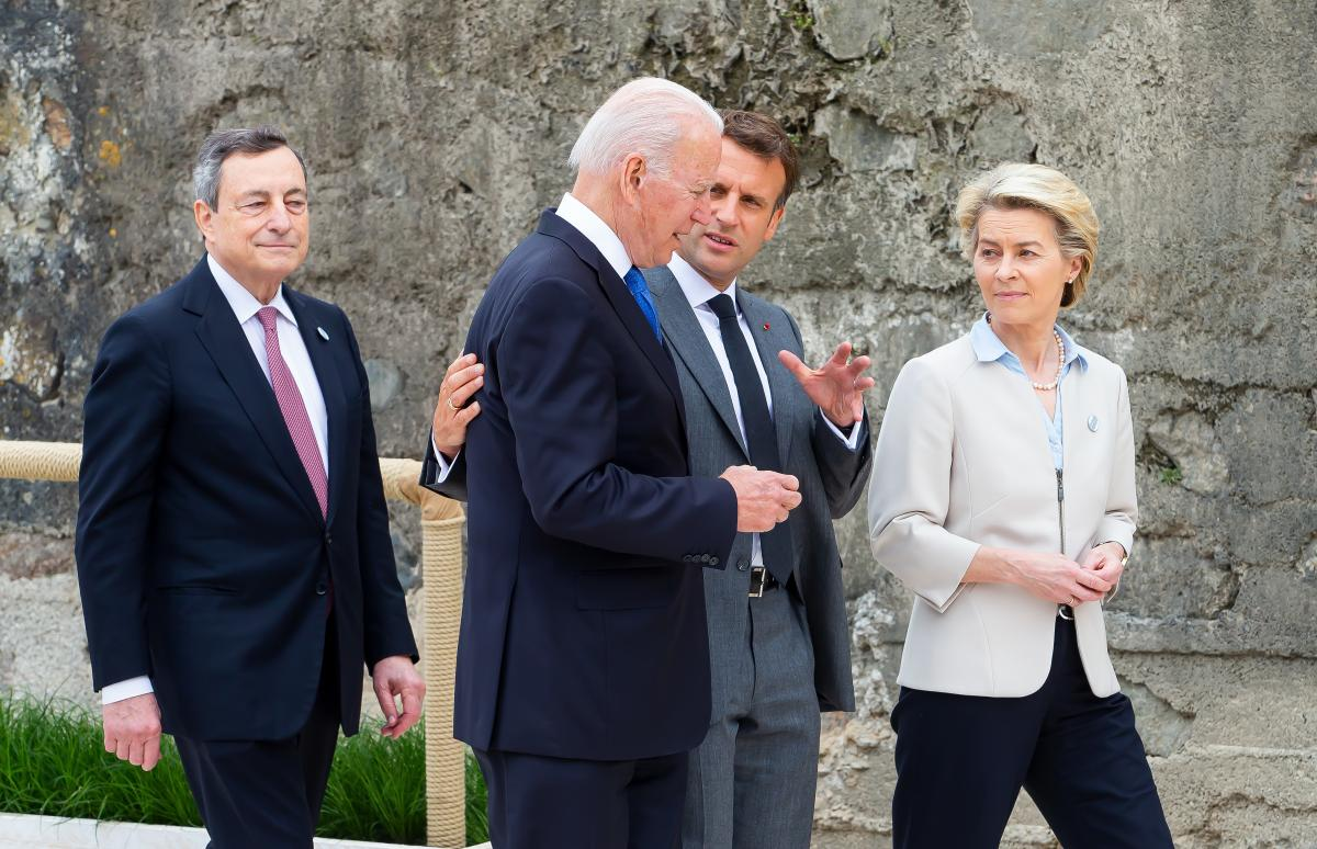 Italian Prime Minister Mario Draghi (from left), President  Biden, French President Emmanuel Macron and European Commission President Ursula von der Leyen speak during the leaders' official welcome Friday.
