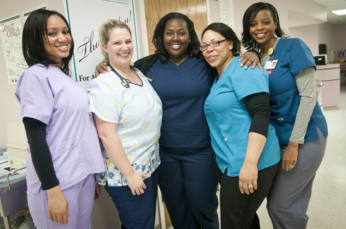 Teammates (from left) Erica Webster, Peggy Renzi, Erika Hersey, Quan Harper and Nyuma Harrison entered a national weight loss contest in hopes of winning $10,000.