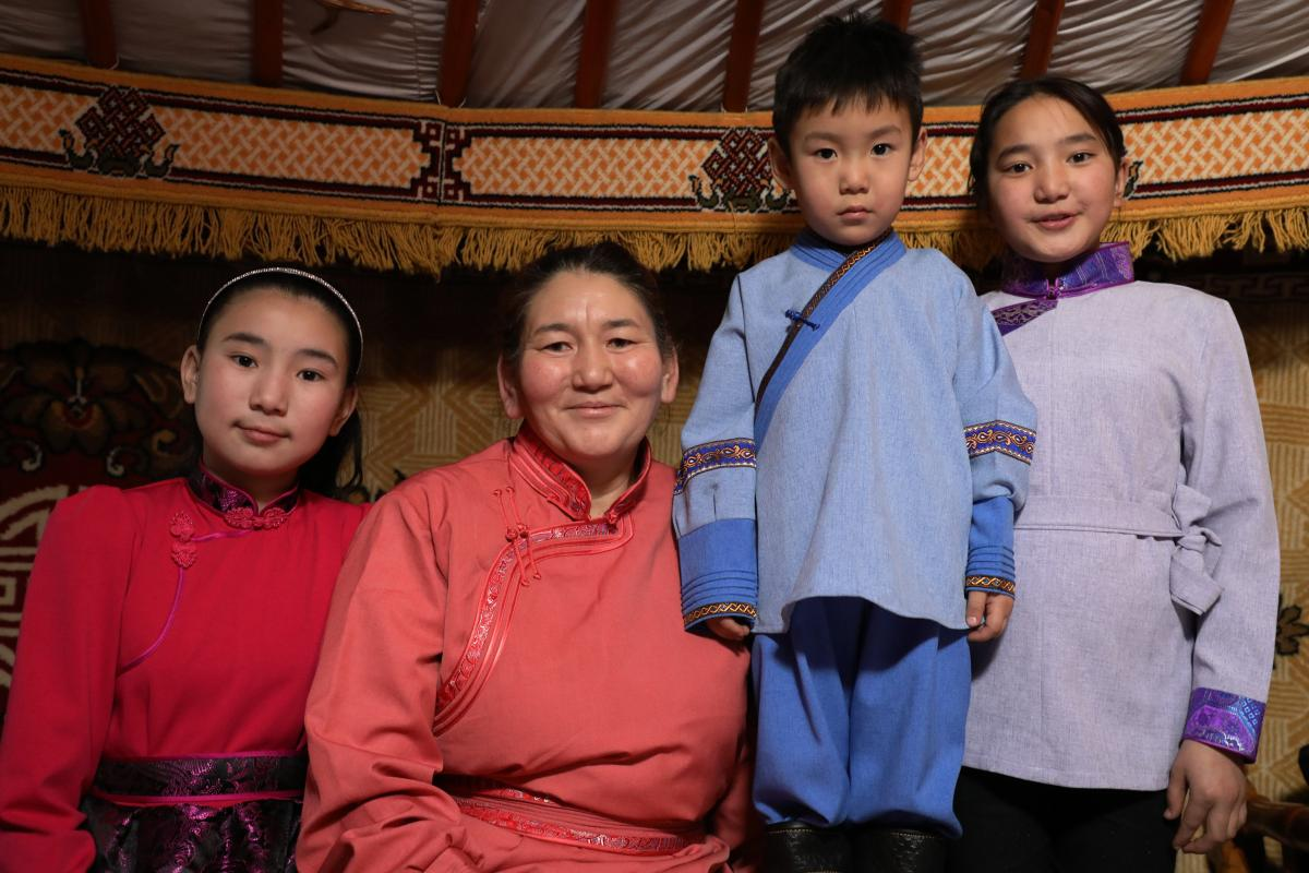 Chantsal Vaanjir (second from left), 46, arrived in Ulaanbaatar in 2001 seeking a job. The former herder now works as a cleaner, living in the ger district with her three school-age children: Uyanga Chantsal (from left), 13; Altanshagai Dorjsuren, 6; and