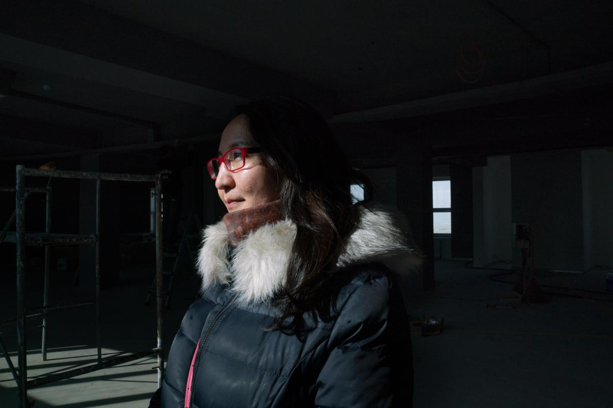 Boloroo Naranbaatar, 43, argues that air quality will improve when quality of life improves in the ger district. She is overseeing a government-led project to expand infrastructure and central services in the most polluted neighborhoods.