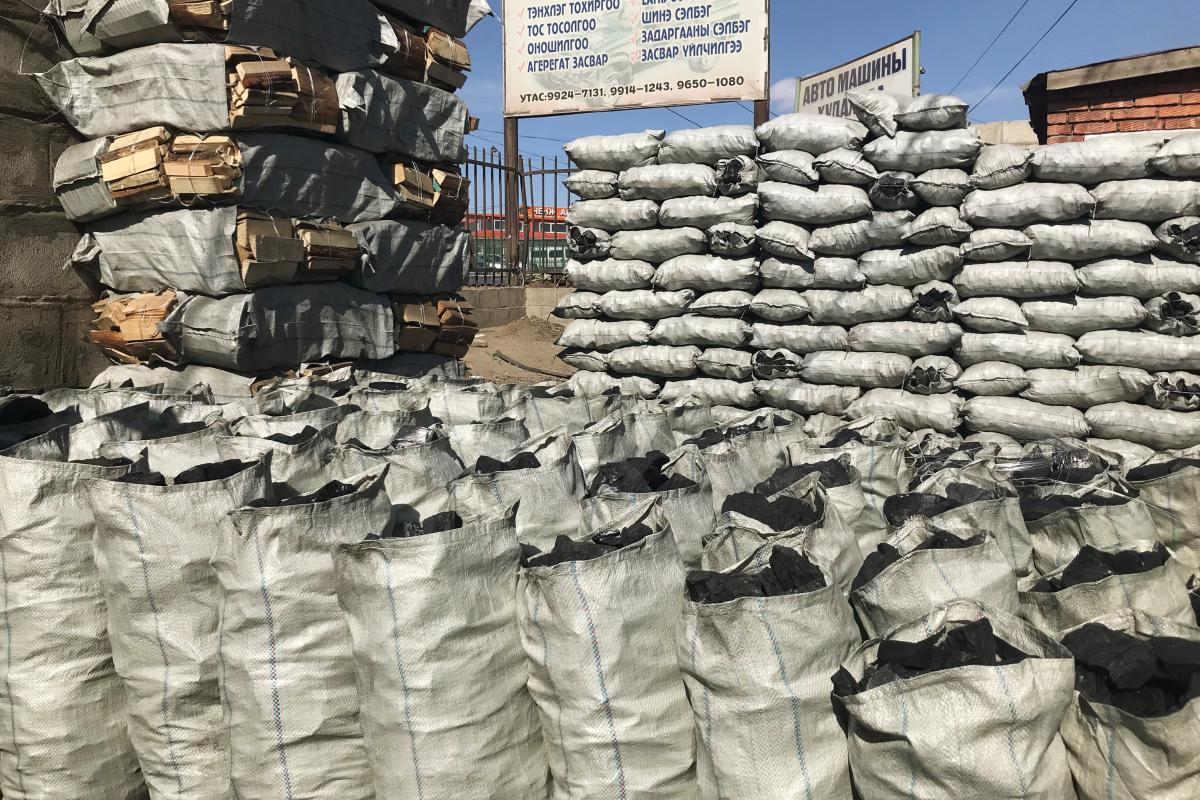 Cheap and plentiful, raw coal (above) is sold throughout the ger district as fuel for heating and cooking. Families burn one or two bags a night. The government plans to replace raw coal with fuel-efficient briquettes made from semicoke.