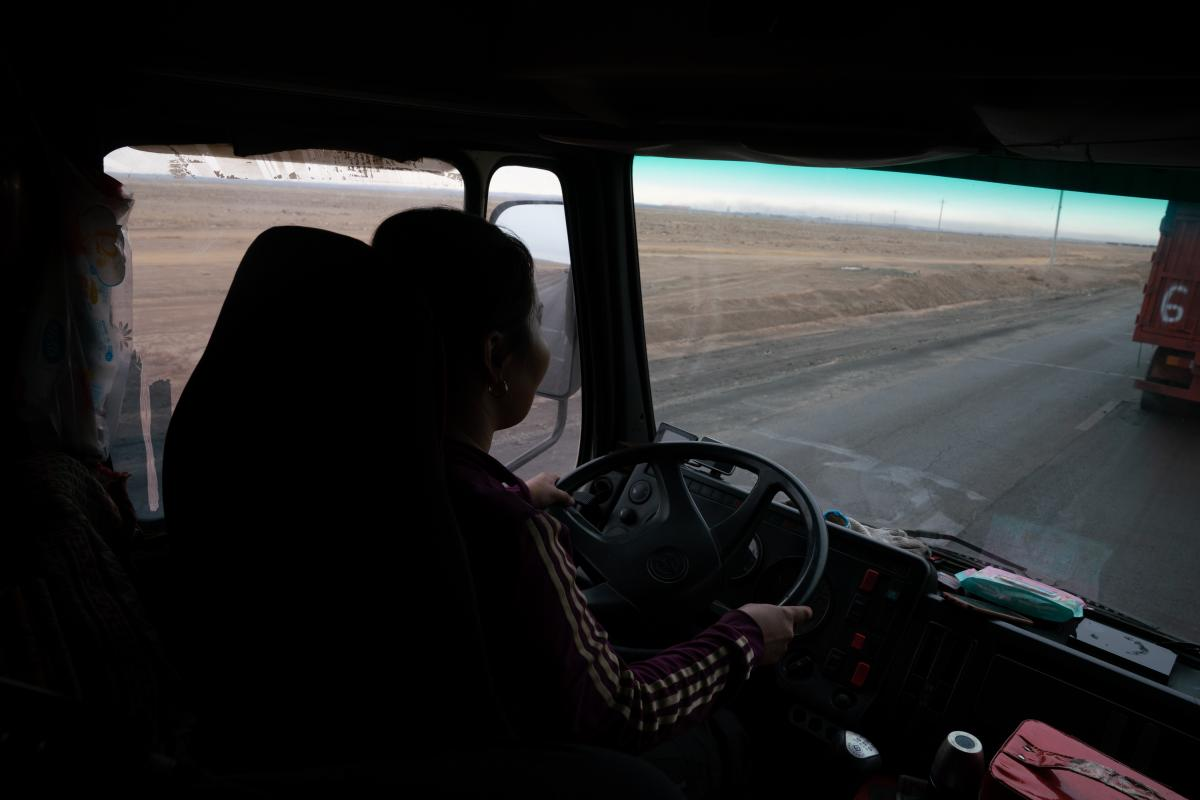 Gulnara Dariiga, 38, drives a truck piled high with coal as she waits to cross the border.  A mining boom in the Gobi Desert is fueling cross-border trade between Mongolia and China, with millions of tons of coal, copper and precious minerals moving by th