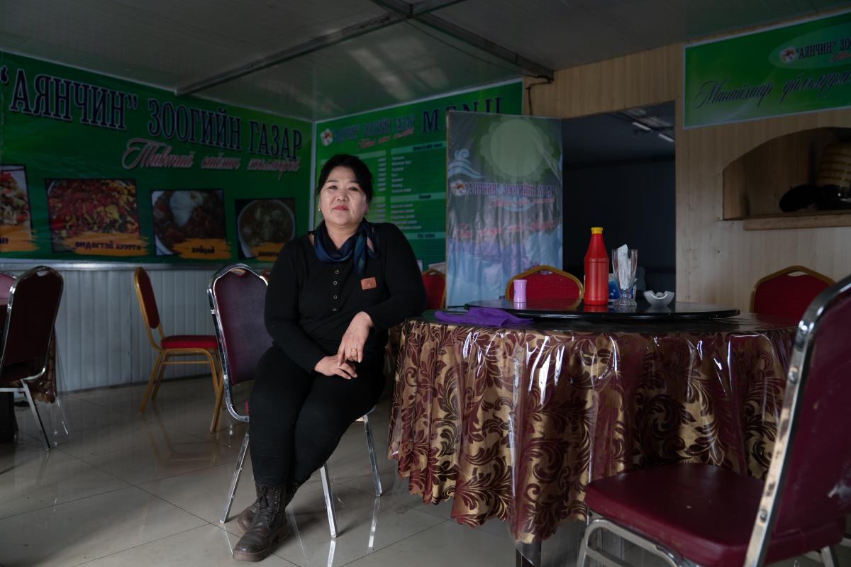 """Batdelger Genden, 53, at her recently opened restaurant in Tsagaan Khad. She calls this region """"Mongolia's Korea,"""" saying, """"This is like the promised land for the Mongolian unemployed, for those who want to make money for honest work."""""""