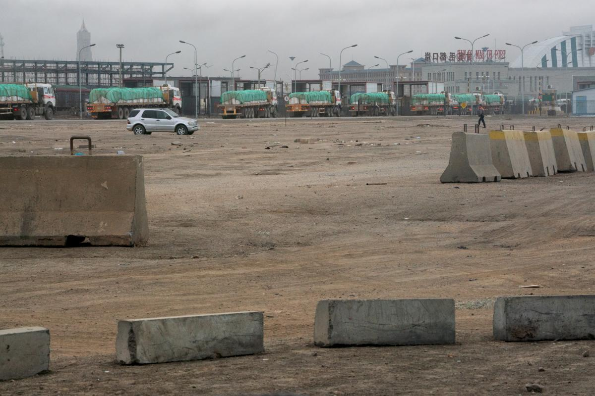 Approximately 1,100 vehicles cross the Mongolia-China border daily. These trucks carry copper concentrate from Oyu Tolgoi, packed in white bags and covered with a green tarp.