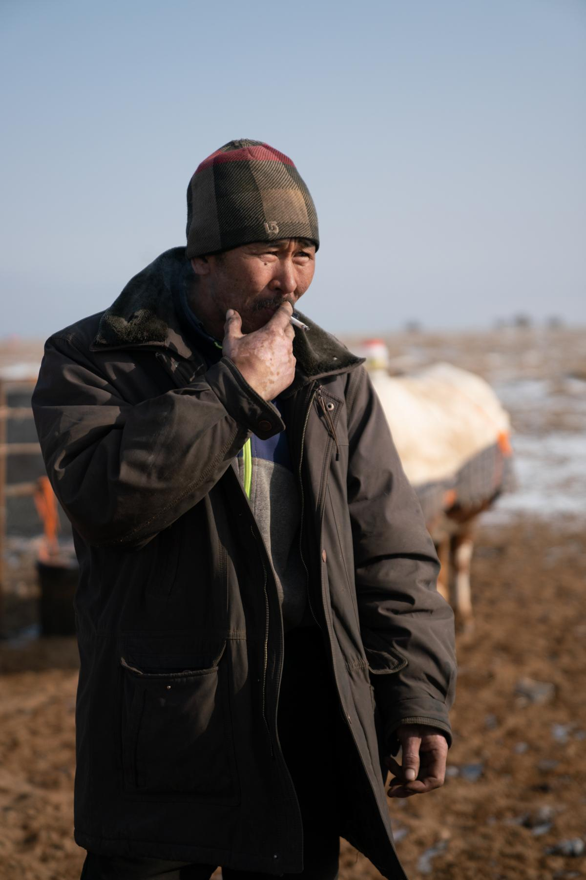 Otgonduu Khuudeg, 51, stands outside his home in the South Gobi. The herder has watched the pastureland change as the mining industry has grown. Six of his camels were killed by passing trucks.