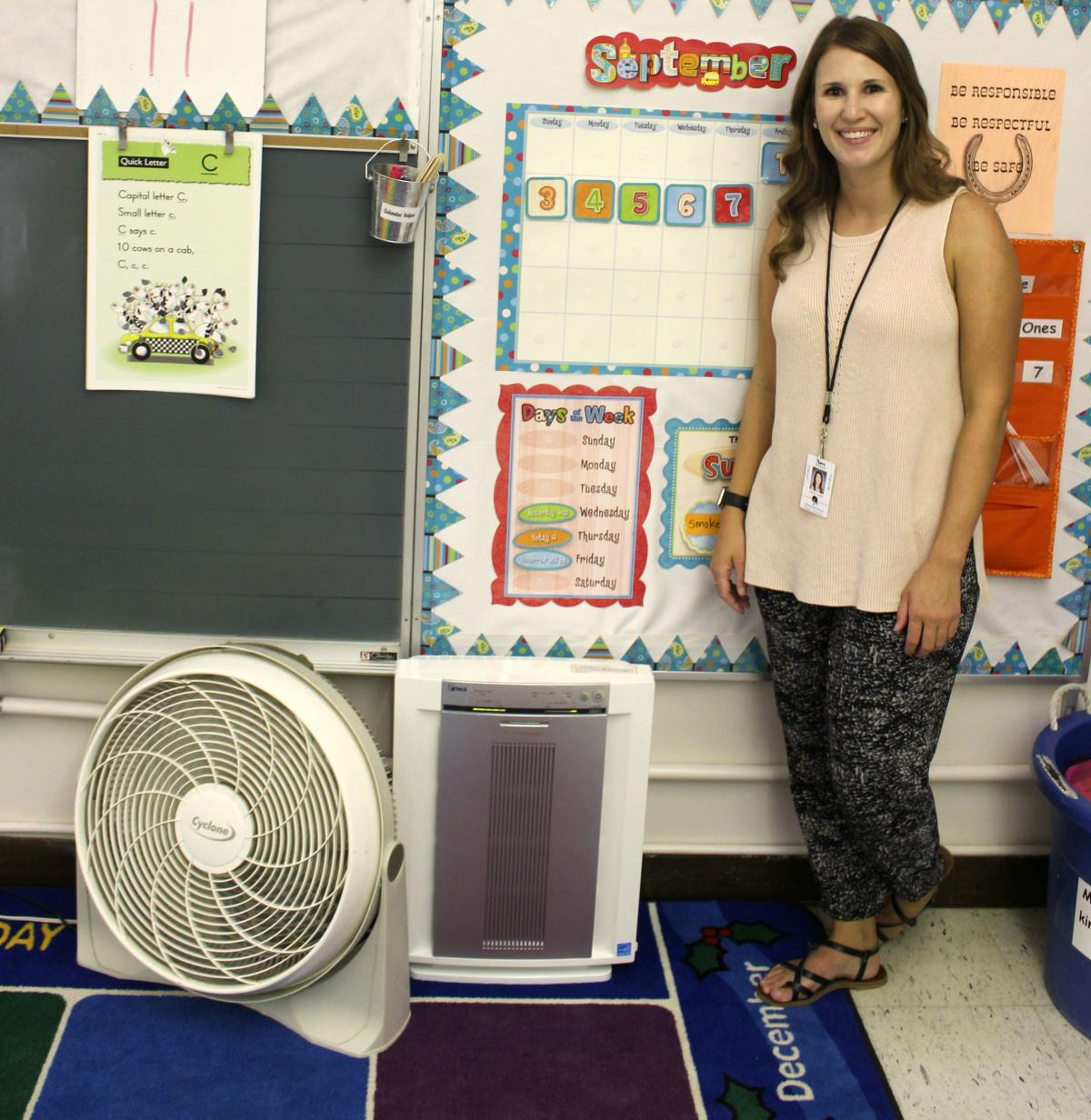 Frenchtown kindergarten teacher Justine Luebke shows off a brand new HEPA air filtration unit that will help purify the air in her classroom.