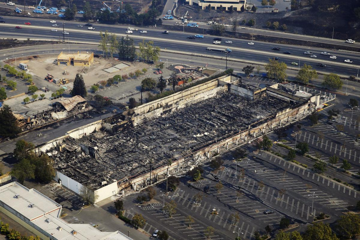 Only a shell of a Kmart store remains on Wednesday in Santa Rosa. Officials in California say they have yet to contain a single major fire.