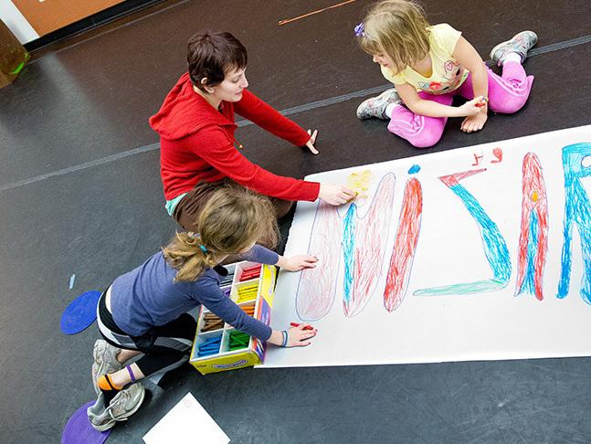 Assistant teacher Charlotte Lang Bush draws with children at Imagination Stage in Bethesda, Md. Staff members and some students at the children's theater and arts center have taken the Torrance Test to measure their creativity.