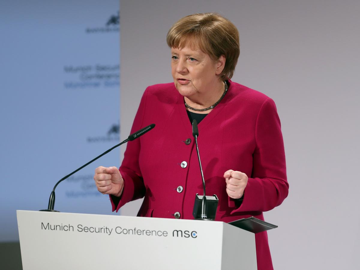German Chancellor Angela Merkel received a standing ovation for a speech that criticized U.S. foreign policy, including the decision to withdraw troops from Syria.