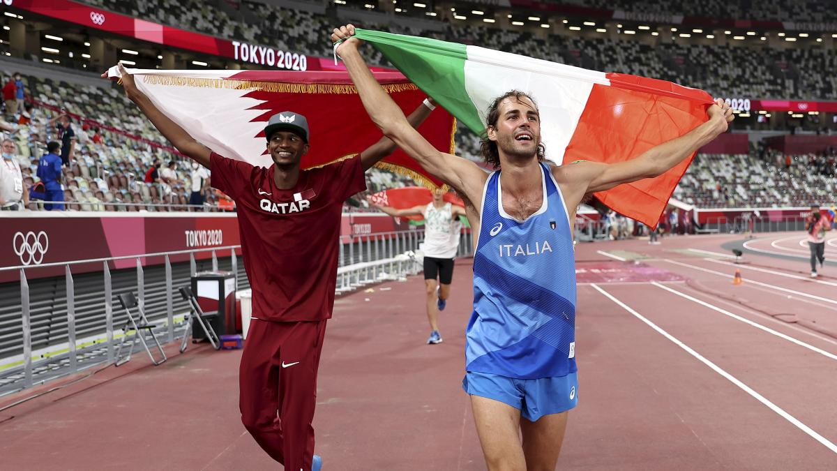 Gold medalists Mutaz Essa Barshim (left) of Qatar and Gianmarco Tamberi of Italy celebrate on the track Sunday.