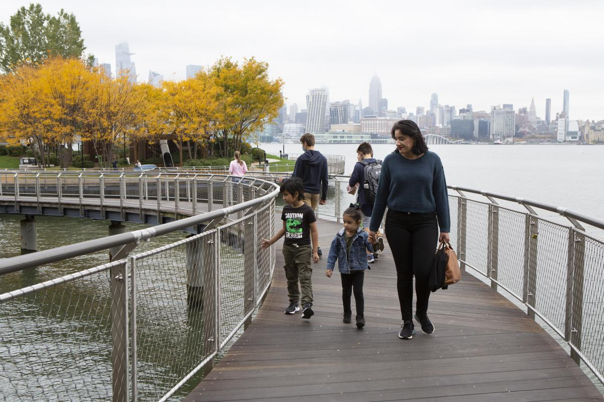 "Sabrina Castillo walks with her children Lorenzo, 5, and Camila, 3, in Hoboken, N.J. ""If one parent has to be home, it's probably going to be — in our culture — it's going to be ... the mother,"" Castillo said."