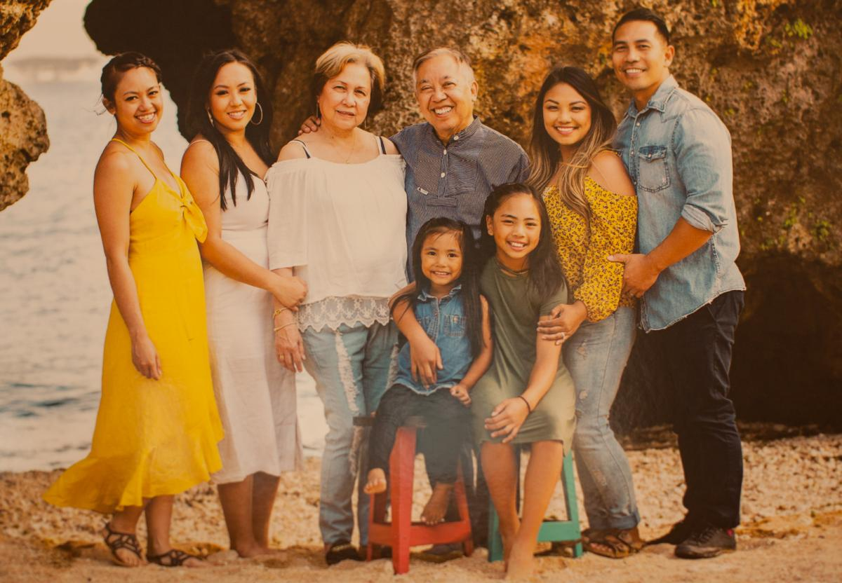 A family photo at the home of Manolo Guerra. The author, Denise Guerra, appears on the far left alongside her sister, mother, father, sister and brother-in-law. Her two nieces appear seated in the front row.