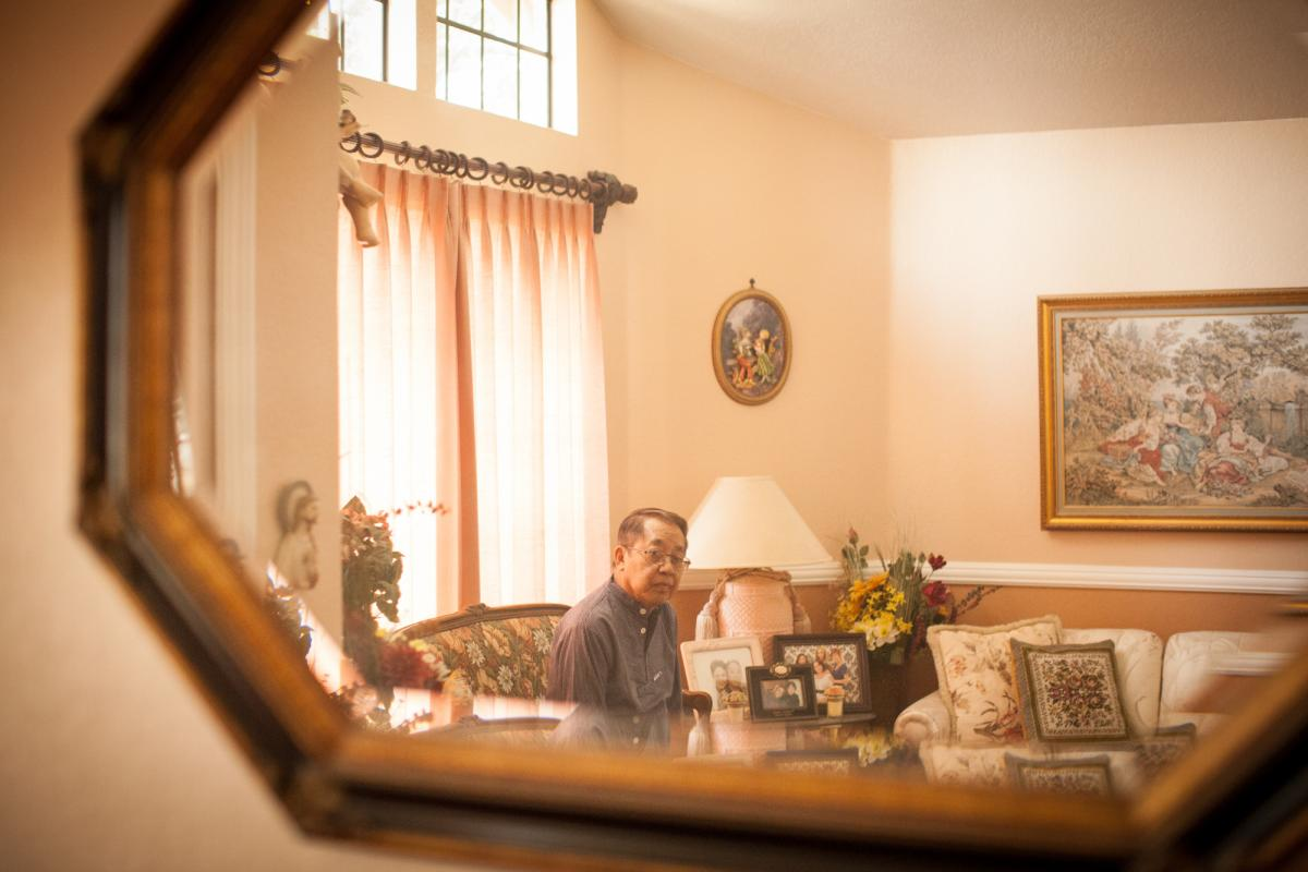 Guerra sits at his home. In the 1980s, Guerra immigrated to the U.S. from the Philippines in search of a better life.