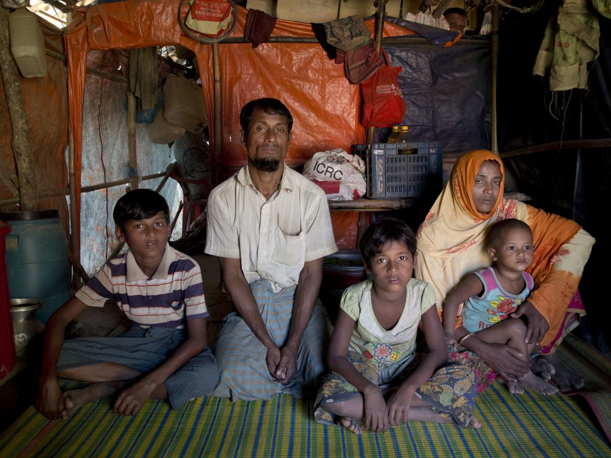 A Rohingya Muslim man Nabi Hossain sits for a photograph along with his family inside the Unchiprang refugee camp near Cox's Bazar in Bangladesh in November 2018.