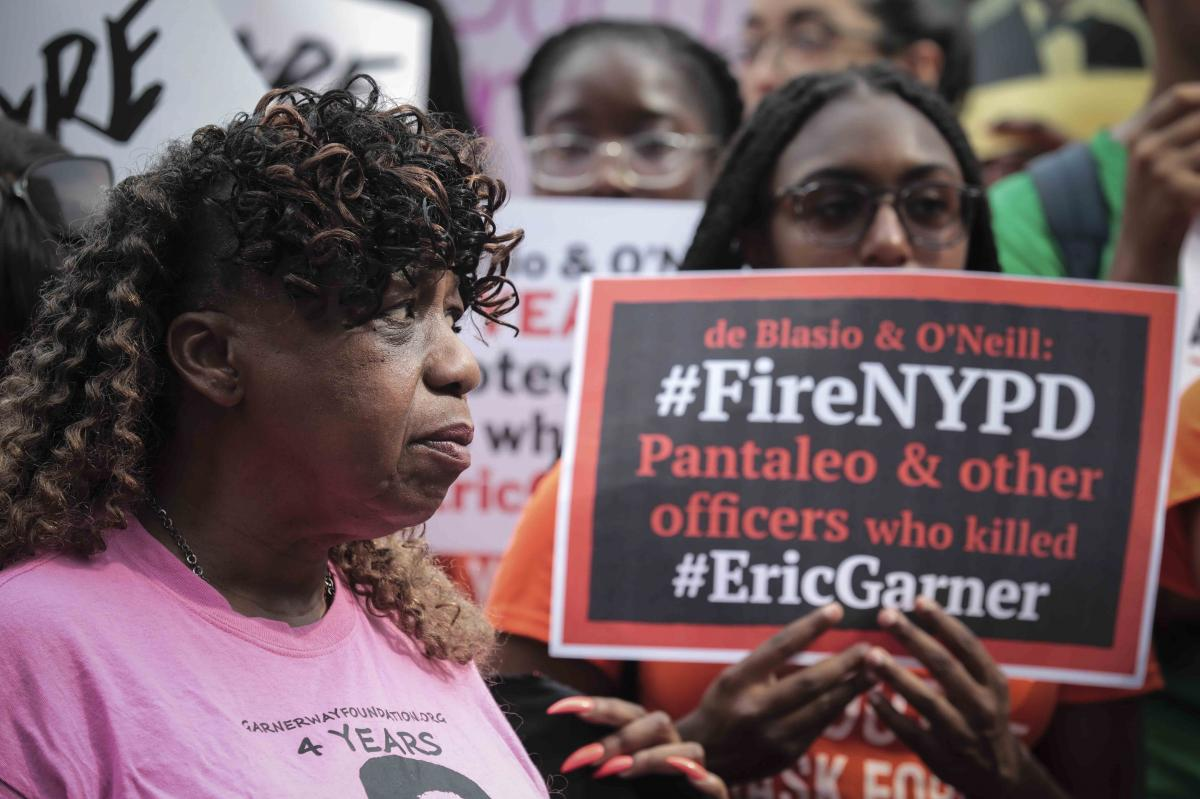 "Gwen Carr (left), mother of Eric Garner, joins a ""young people"" rally in Federal Plaza to protest the decision by federal prosecutors last month not to bring civil rights charges against New York City police Officer Daniel Pantaleo over Garner's death in"