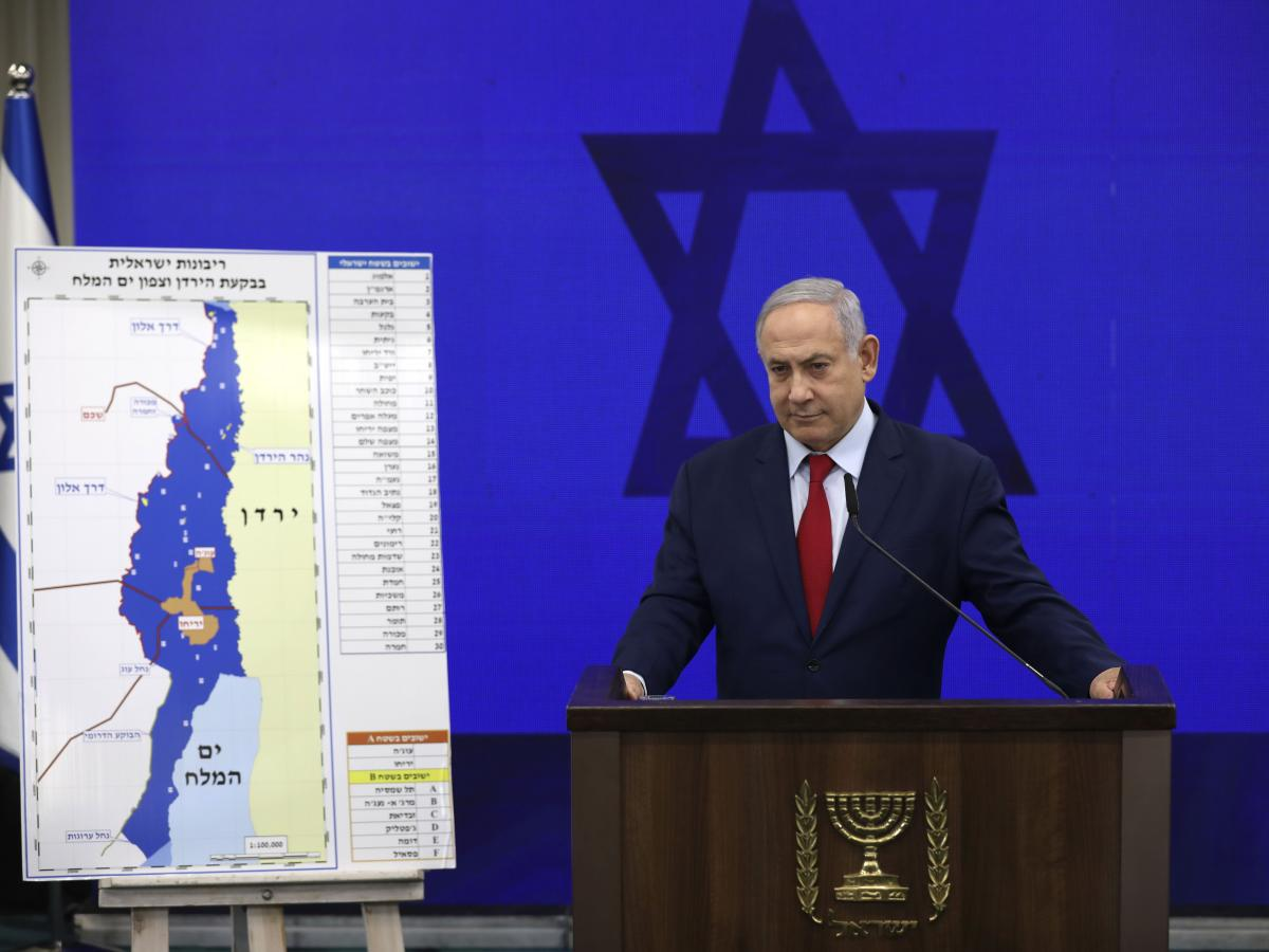 Netanyahu tells reporters on Sept. 10 in Tel Aviv  that he will annex West Bank settlements if he wins the national elections.