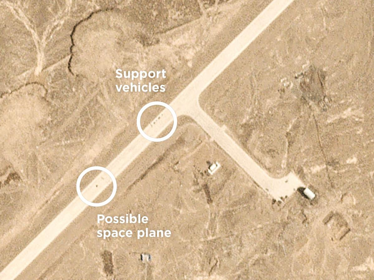 A photo snapped by a passing commercial satellite shows objects on the airstrip at 10:11 a.m. local time on Sept. 6, just minutes after a scheduled landing would have occurred.