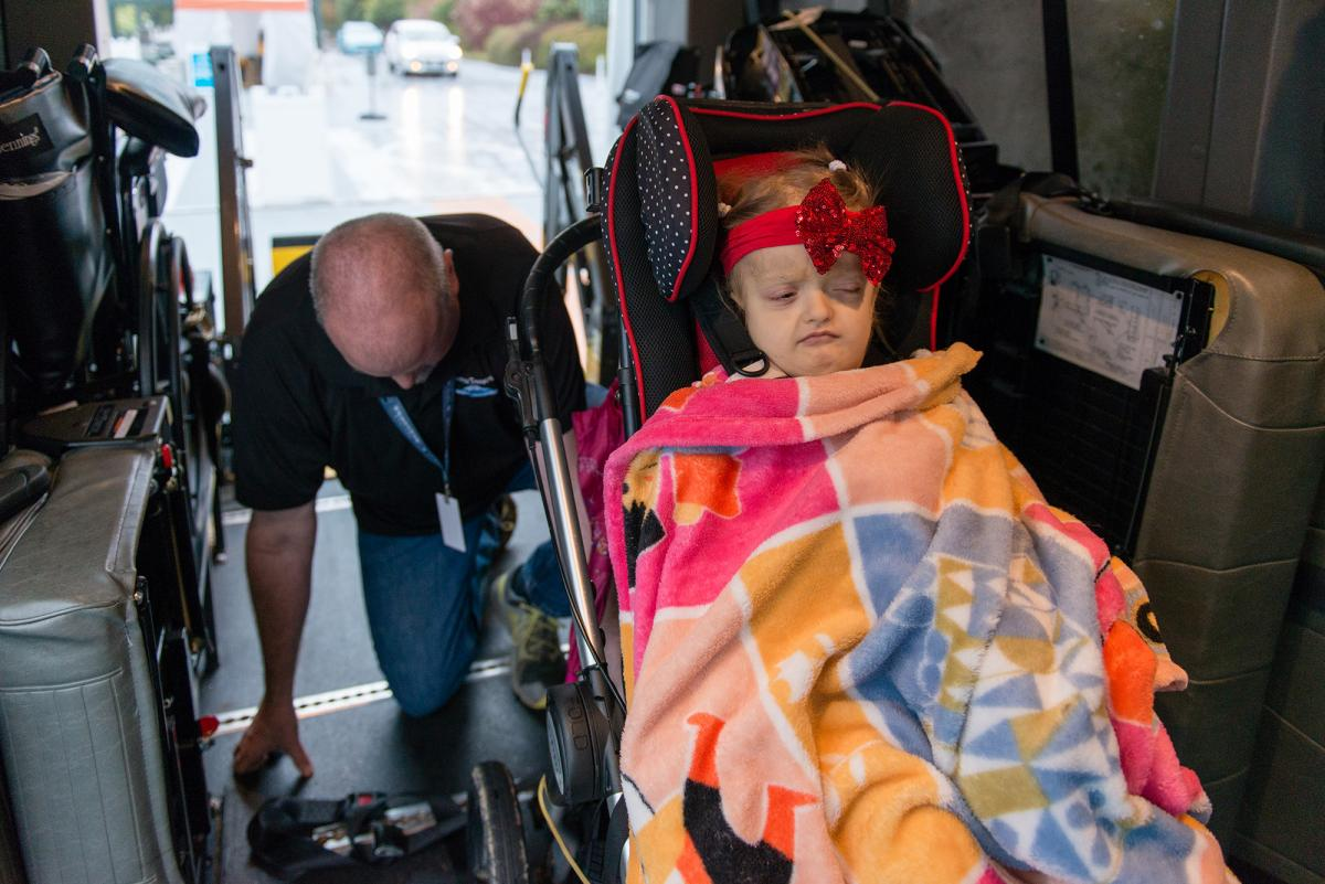 Donavan Dunn is trained to drive fragile Medicaid patients like Maddie Holt of Everett, Wash., to health appointments.