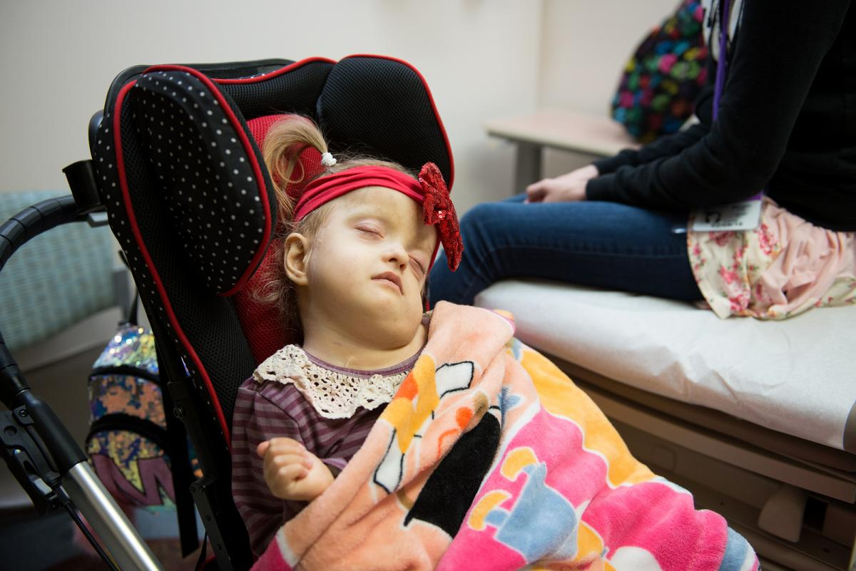 Maddie Holt, 5, was born with a rare genetic condition called Zellweger syndrome and is unable to walk or talk and can barely see or hear.