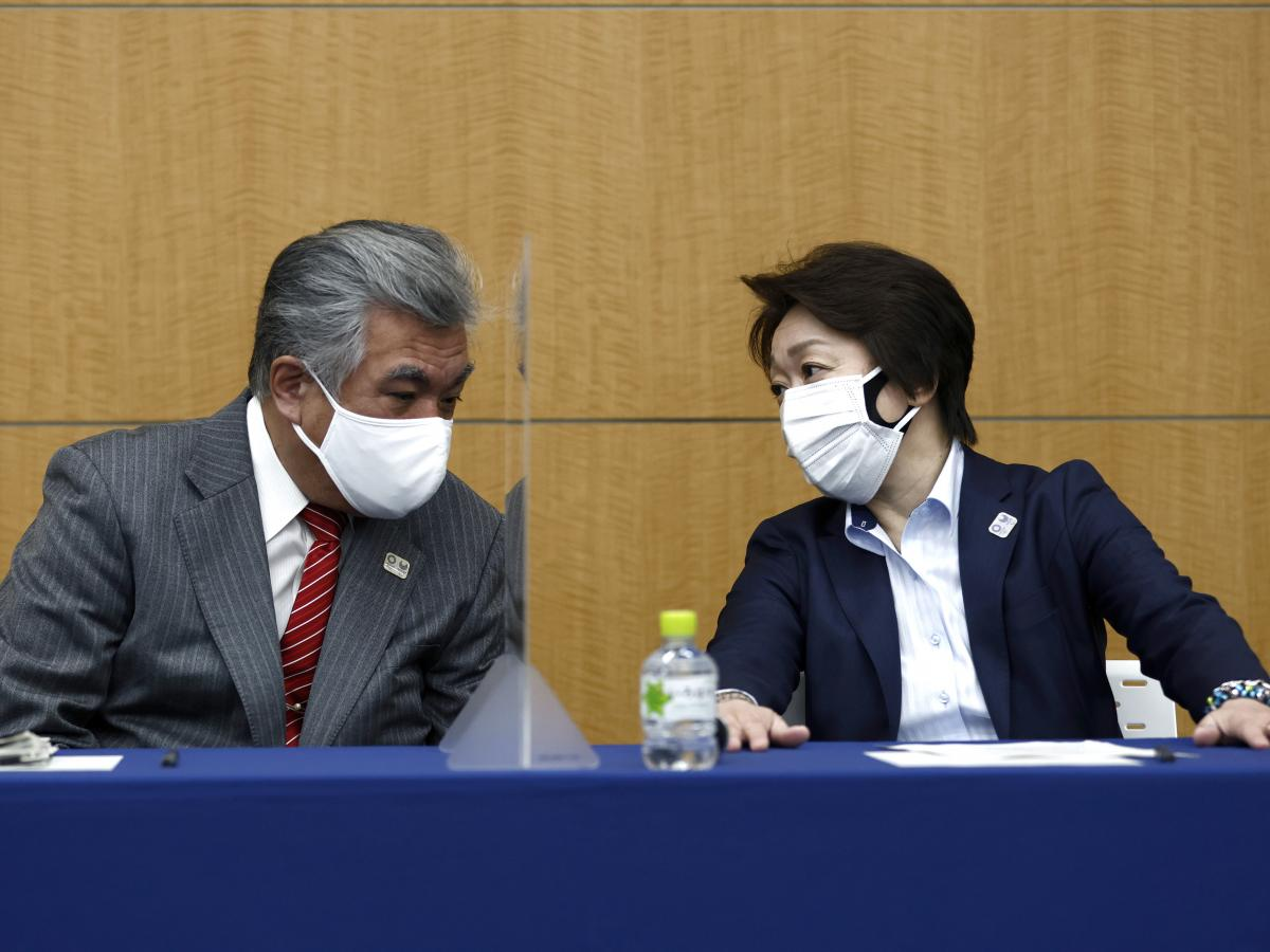 President of the Tokyo 2020 Olympics Organizing Committee Seiko Hashimoto (right) talks to Tokyo 2020 Vice Director General Yukihiko Nunomura before a press briefing on the operation and media coverage of Tokyo 2020 Olympic Torch Relay in Tokyo on Thursda