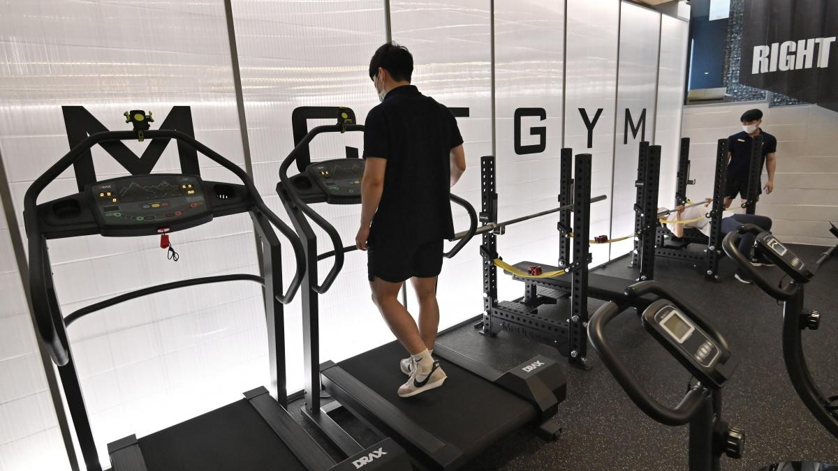 People exercise at a gym in Seoul on Tuesday as South Korea announced implementation of level 4 social distancing measures amid concerns of a fourth wave of the coronavirus pandemic.