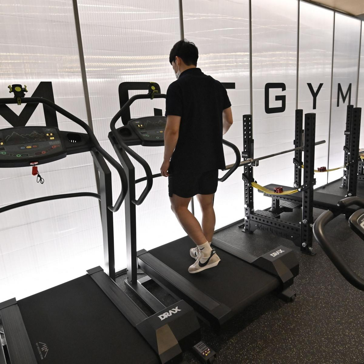 People exercise at a gym in Seoul on July 13, 2021 as South Korea announced implementation of level 4 social distancing measures amid concerns of a fourth wave of the coronavirus pandemic.