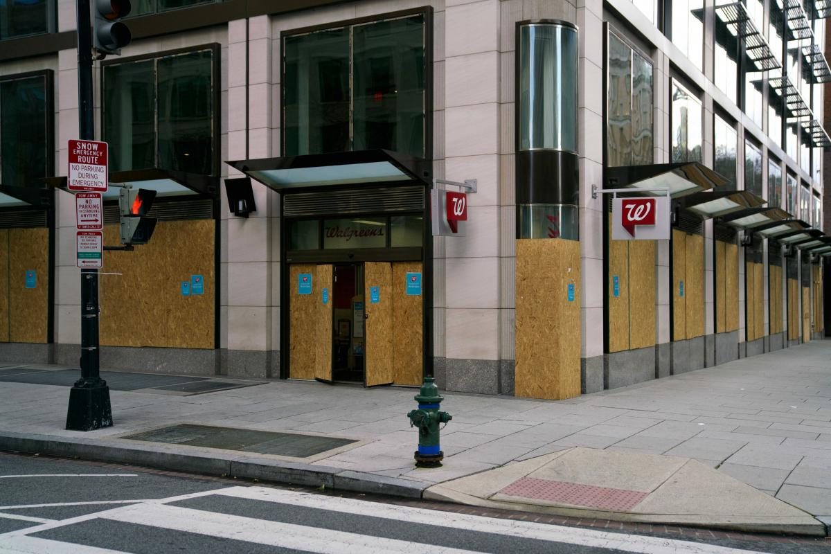 A Walgreens is boarded up in a nearly empty part of downtown Washington, D.C., on Wednesday.