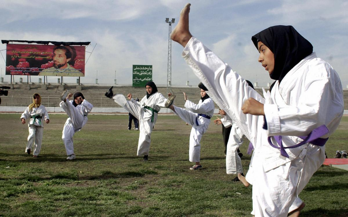 Afghan girls practice taekwondo at Kabul Stadium on International Women's Day in 2004.