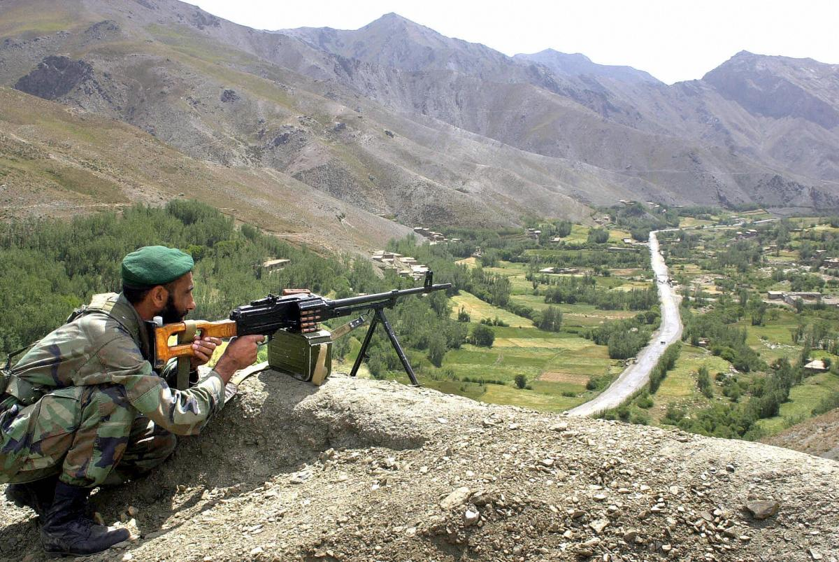 An Afghan soldier keeps watch above a road leading to the Salang Tunnel during Afghan President Hamid Karzai's visit on Aug. 27, 2003.