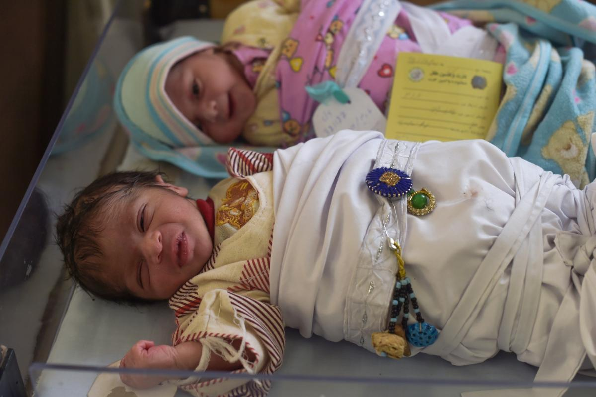 Newborn babies are wrapped in blankets at a maternity ward in the Malalai Maternity Hospital in Kabul on Dec. 26, 2017.