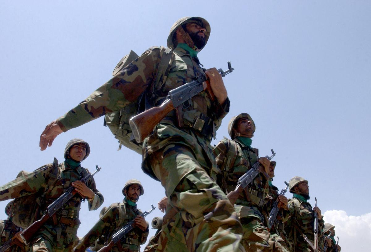 Afghan National Army soldiers march at a ceremony marking the end of a formal disarmament and reintegration program in Kabul on July 7, 2005. Afghanistan said it had completed the first stage of the U.N.-backed disarmament program aimed at collecting weap