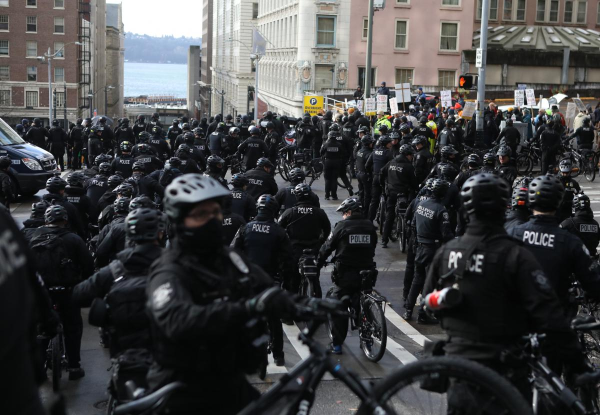 Seattle police officers on bicycles confront protesters during the United Against Hate rally in Seattle last month.