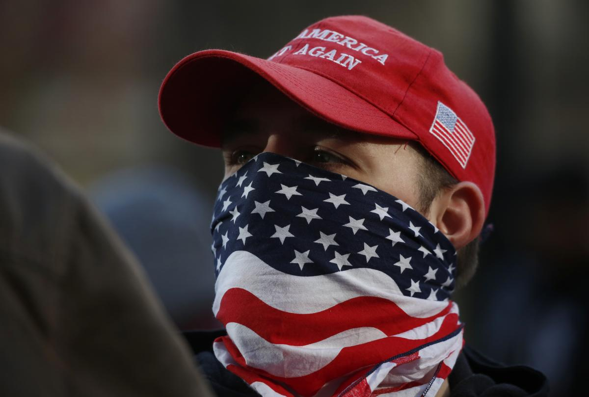An attendee wears an American flag mask during the United Against Hate rally by the Washington Three Percent in Seattle last month.