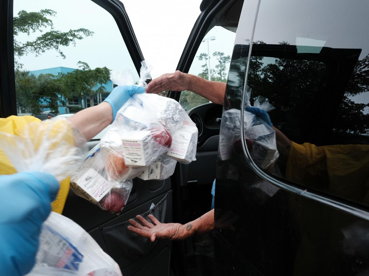 Food is distributed during a mobile food pantry in the agricultural community of Immokalee, Fla., on Feb. 16. Requests for help have surged during the pandemic.