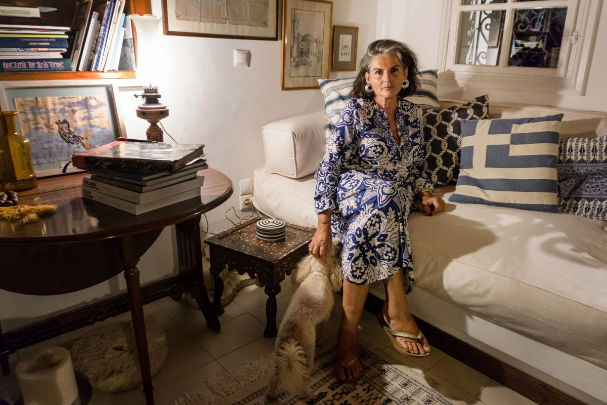 Constantina Agapitou Crowley, a former marketing executive and sixth-generation Kastellorizian, serves as the island's ambassador-at-large. She is pictured at home with her dog, Zoe.