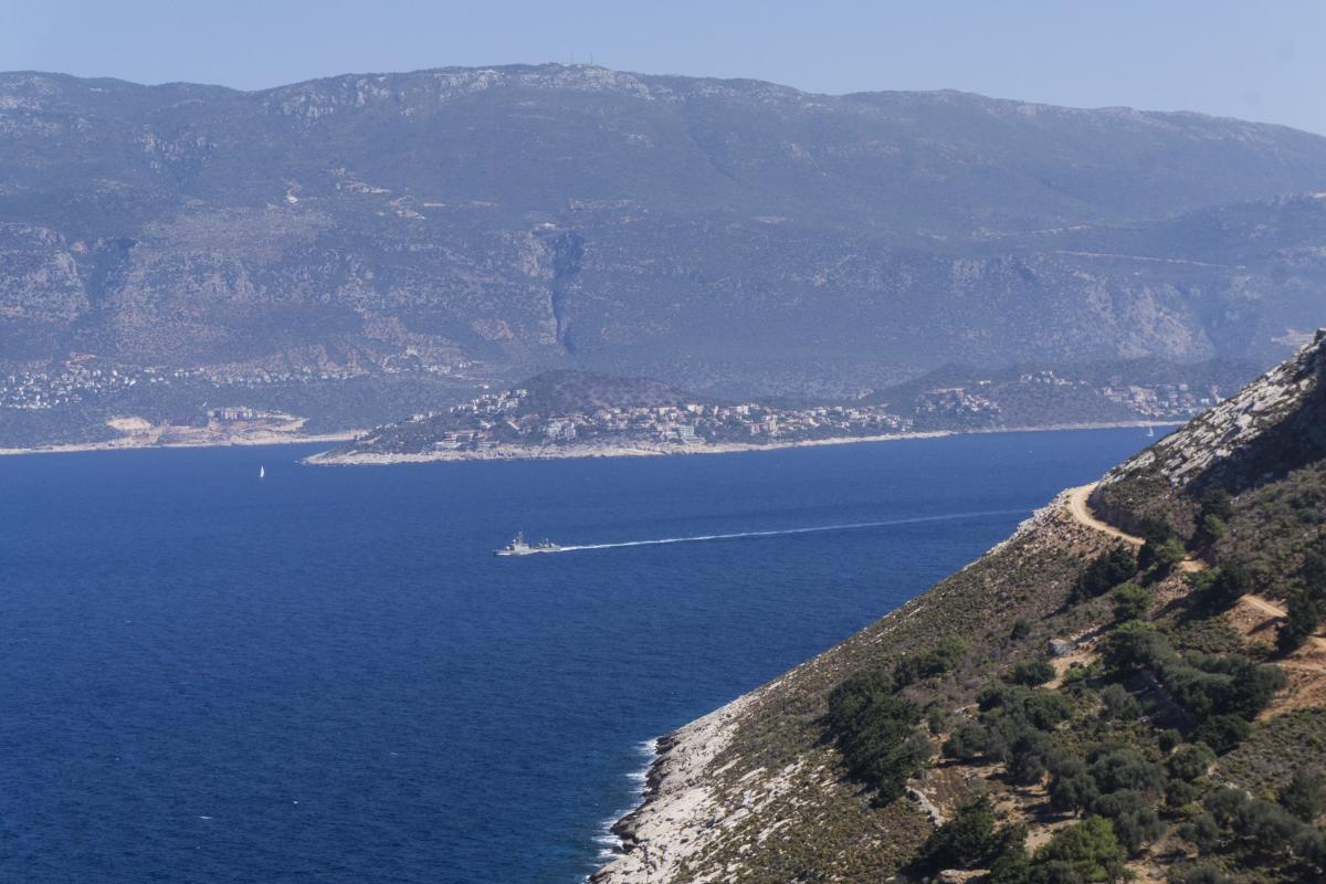 A Greek military ship glides along the stretch of sea between Kastellorizo and the neighboring Turkish town of Kas.