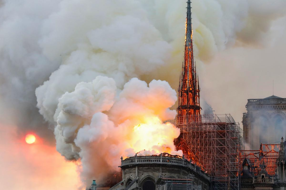Smoke and flames rise from the famed cathedral.