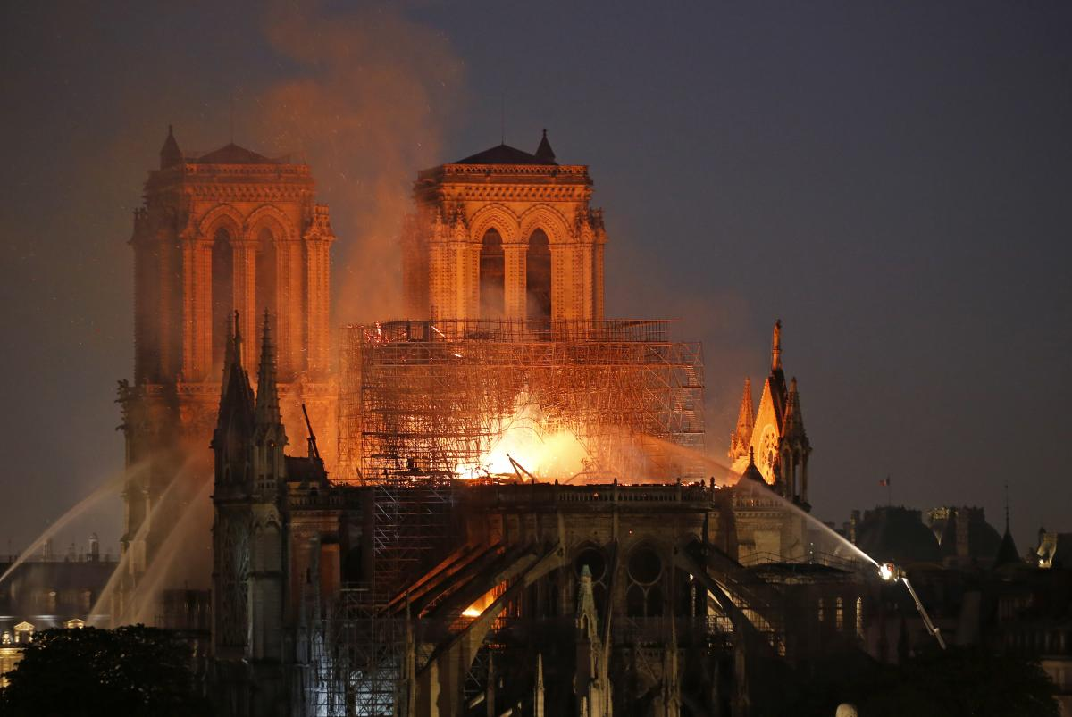 Flames and smoke are seen billowing from the roof at Notre Dame Cathedral in Paris on Monday.