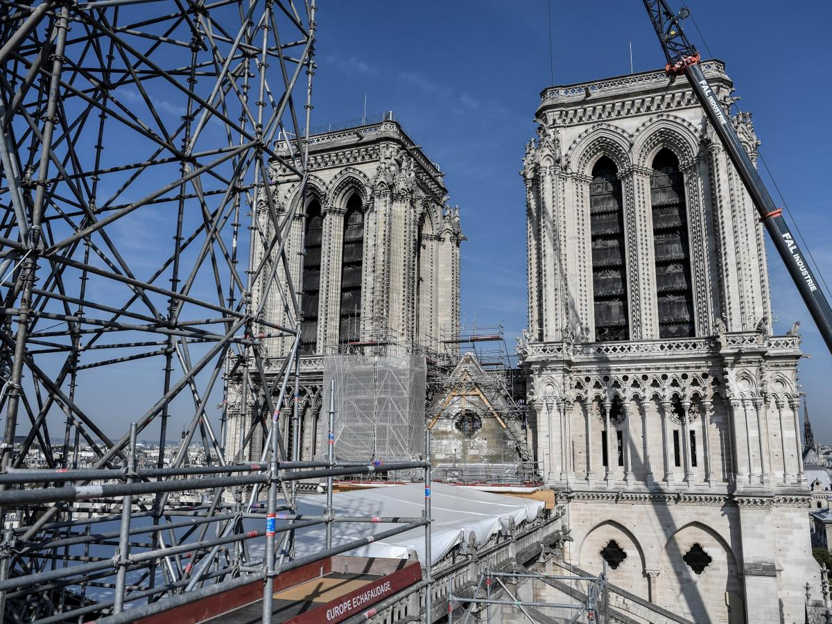 Scaffolding is seen during preliminary work on top of the Notre Dame cathedral three months after a major fire in Paris.