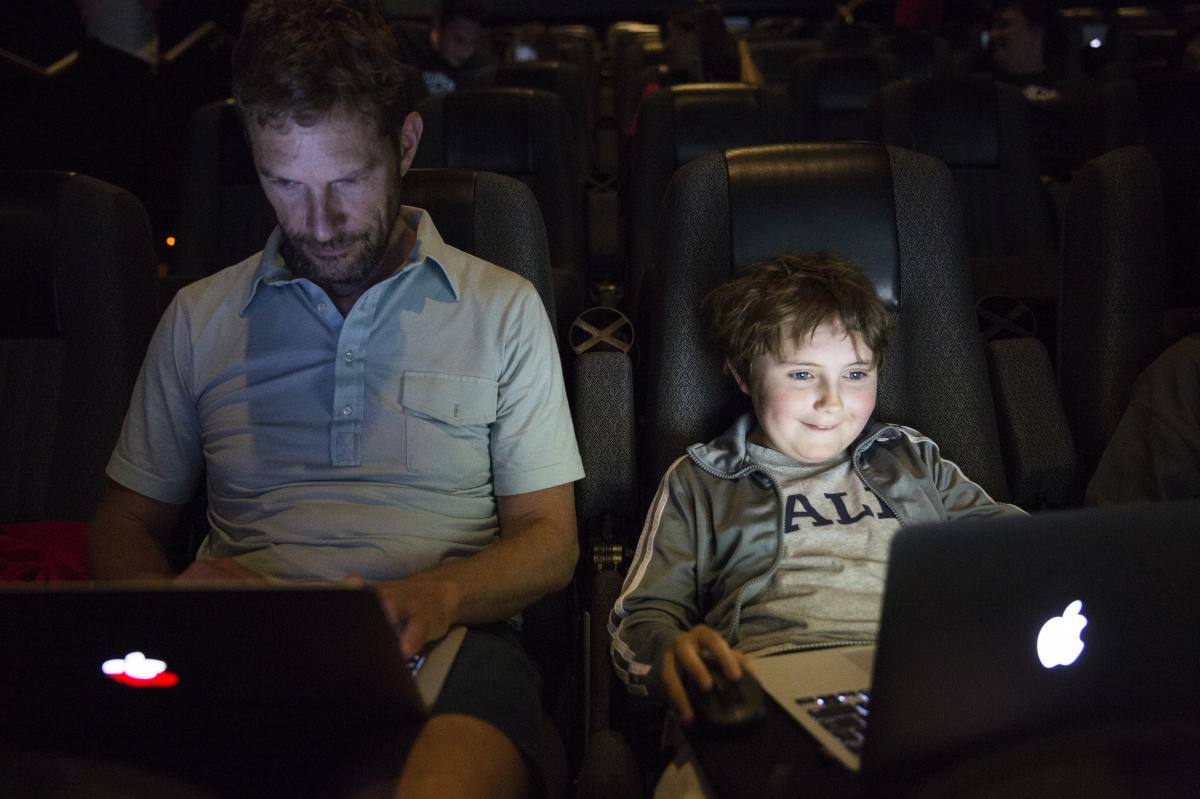 """Jon Ogilvy plays Minecraft with his son, Nathaniel, 9. Jon said he hasn't played the game in awhile. """"I'm a little rusty,"""" Jon said. """"He's a noob,"""" Nathaniel responded."""