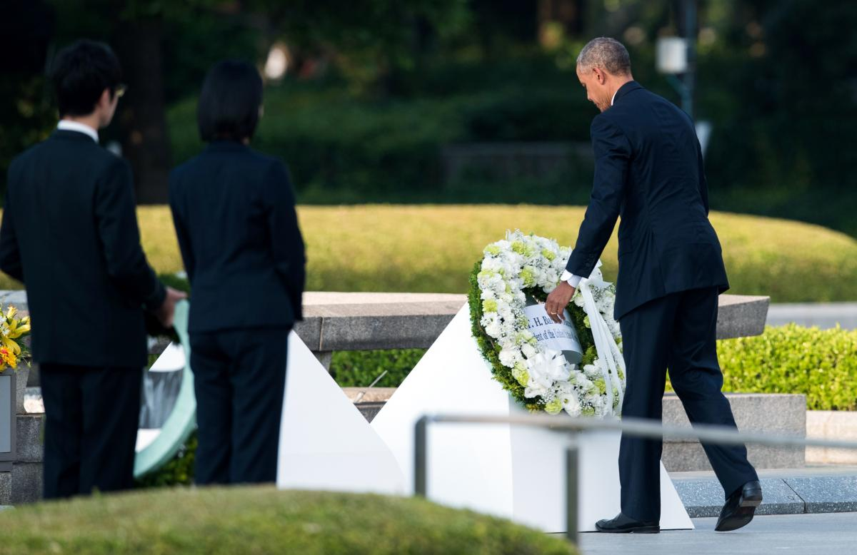 Obama lays a wreath at the Hiroshima Peace Memorial Park Cenotaph on Friday. Obama is the first sitting U.S. leader to visit the site that ushered in the age of nuclear conflict.